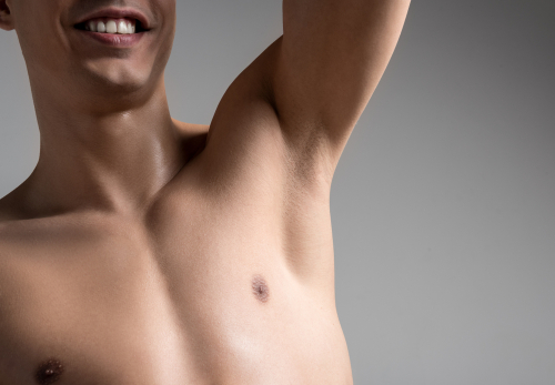 man standing with raised hand and expressing satisfaction from hairless underarm-img-blog